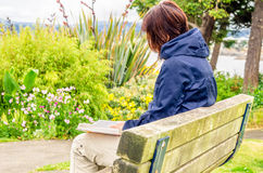 Woman Reading a Book in a Park Royalty Free Stock Photos