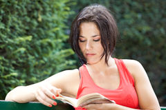 Woman reading a book peacefully Royalty Free Stock Image