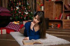 Woman reading a book royalty free stock photos