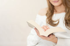 Woman reading book and relaxing Stock Photo