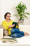 Woman reading book relaxing home vacation free time Royalty Free Stock Photography