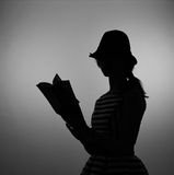 Woman reading a book - silhouette Stock Photography