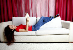 Woman Reading A Book On Sofa Royalty Free Stock Images