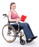 Woman reading book on the wheelchair Royalty Free Stock Image