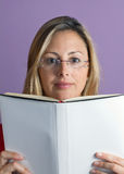 Woman reading a book white cover Royalty Free Stock Images