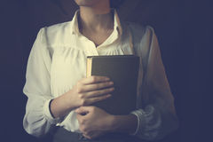 Woman reading a book. Woman white shirt reading a book Royalty Free Stock Images