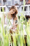 Woman reading a book. Young woman reading a book royalty free stock photos