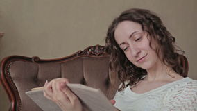 Woman reading a book stock footage