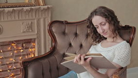 Woman reading a book stock video