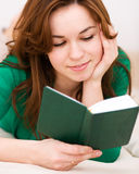Woman is reading a book Stock Image