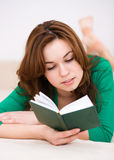 Woman is reading a book Royalty Free Stock Photos