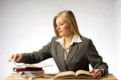 Woman reading books. Student, businesswoman or teacher works with opened book Royalty Free Stock Image