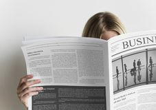 A woman reading business newspaper Royalty Free Stock Photo