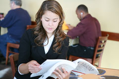 Woman Reading in the Cafe Stock Photos