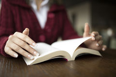 Woman reading at cafe. Woman Reading Book At Cafe selective focus Royalty Free Stock Photography