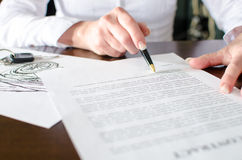 Woman reading a car purchase contract Stock Images