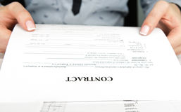 Woman reading contract Stock Image