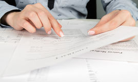 Woman reading contract terms Stock Photo
