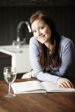 Woman reading a cookery book Royalty Free Stock Photo