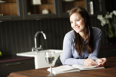 Woman reading a cookery book Stock Photo