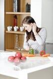 Woman reading cookery book Stock Photos