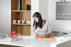 Woman reading cookery book Royalty Free Stock Image