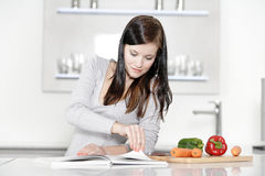 Woman reading cookery book Royalty Free Stock Photos