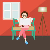 Woman reading in corner  living room house home window glasses Stock Photography