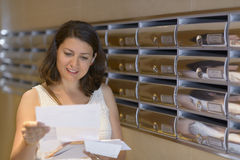 Woman Reading Correspondence Stock Images