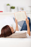 Woman reading on a couch Stock Photography