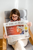 Woman reading Die Zeit  with Marine Le Pen on cover Royalty Free Stock Photos