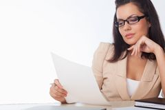 Woman reading document Royalty Free Stock Images