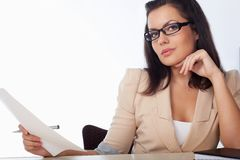 Woman reading document Royalty Free Stock Photo