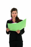 Woman reading through document Royalty Free Stock Images
