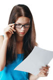 Woman reading document. Brunette young woman shocked realizes that something amazing or bad happened reading a white letter or document stock photography