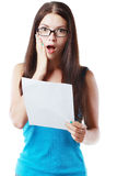 Woman reading document. Brunette young woman shocked realizes that something amazing or bad happened reading a white letter or document royalty free stock image