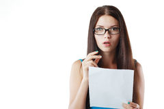 Woman reading document. Brunette young woman shocked realizes that something amazing or bad happened reading a white letter or document stock photo