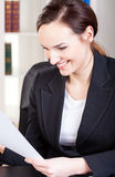 Woman reading document Stock Photography