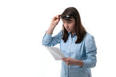 Woman reading a document Royalty Free Stock Photography