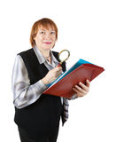Woman reading documents through magnifier Stock Images