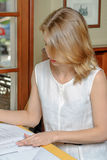 Woman reading documents Stock Photo