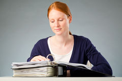 Woman Reading Documents Royalty Free Stock Photography