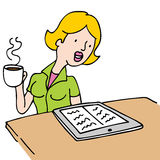 Woman Reading An Ebook and Drinking Coffee Stock Photography