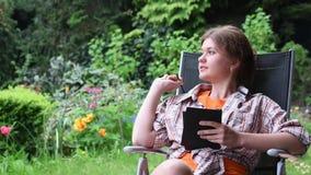 Woman reading ebook stock footage