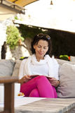Woman reading a a fascinating book outdoor Royalty Free Stock Photo