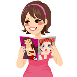 Woman Reading Fashion Magazine Stock Images