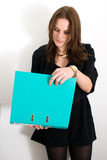 Woman Reading File From A Binder. Woman Reading File From A Blue Binder Stock Image