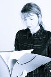 A woman reading through a folder (2) Royalty Free Stock Image