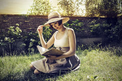 Woman reading in the garden Royalty Free Stock Images