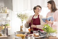 Woman reading grandmother recipes stock photos